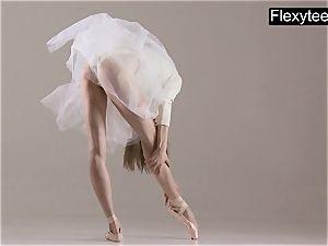 towheaded gymnast performs gymnastics