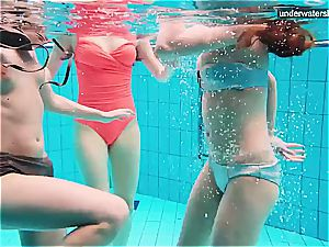 trio naked dolls have fun underwater