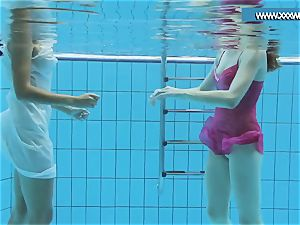 Hotly clothed teenagers in the pool