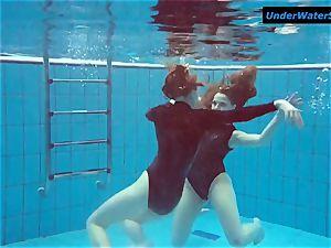 two molten teenagers underwater