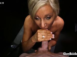 cougar blowing strangers sausages in random gloryhole