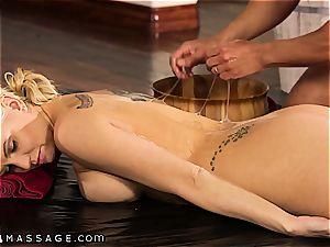 busy blonde getting a Nuru massage