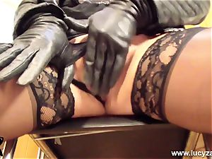 blond milf Lucy Zara in all leather playthings her moist muff