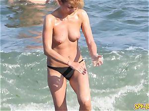 warm topless amateur mummies hidden cam Close-up Beach vids