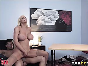 voluptuous light-haired jiggles her forms on the boss'cock