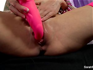 Sarah Jessie smashes herself with a pink plaything