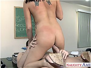 Geeky student Danica Dillan plowing her instructor