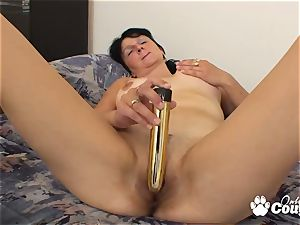 dark-haired milf jerking with enormous vibro on bed