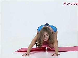nimble teenage Anka demonstrates bare gymnastics